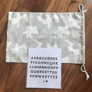 Dagne Dover dust bag and stickers